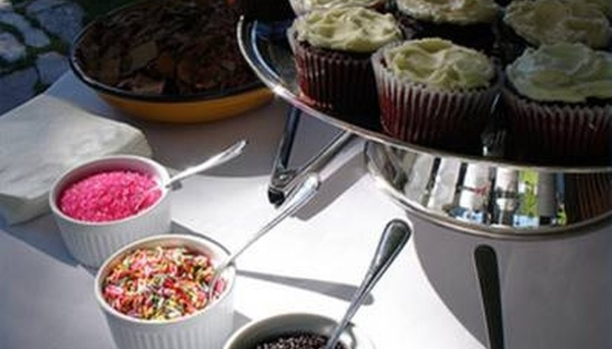 A cupcake bar with sprinkles and chocolate shavings