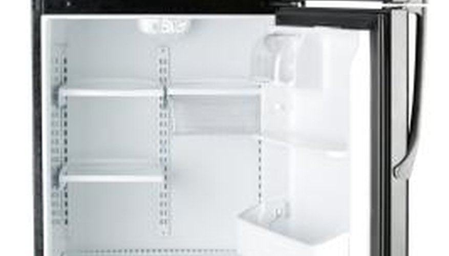 The ice maker mounts in the refrigerator's freezer compartment.