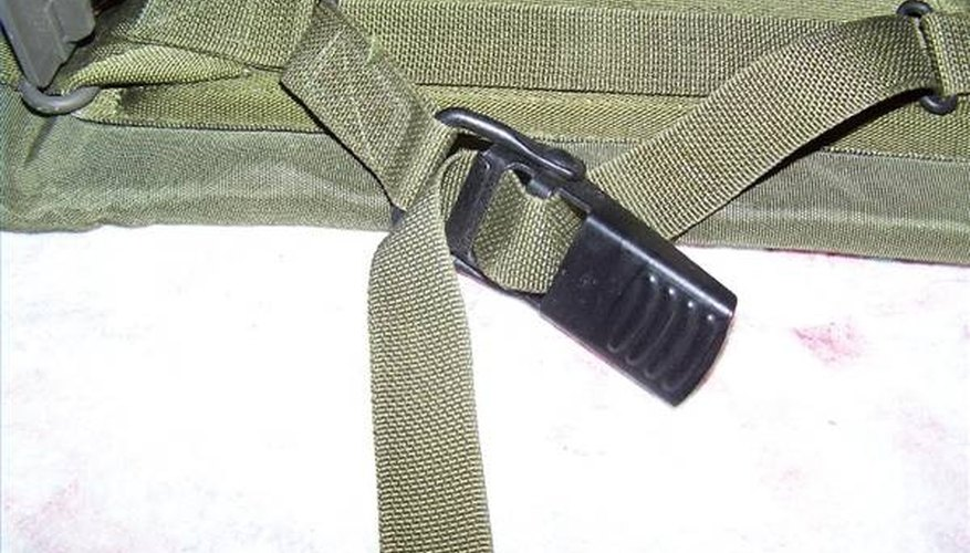 As long as you can pull the strap tight securely, it doesn't really matter which way the buckle faces.
