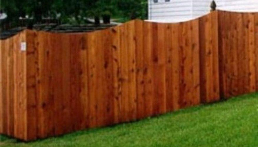 A decorative scalloped cedar fence design.