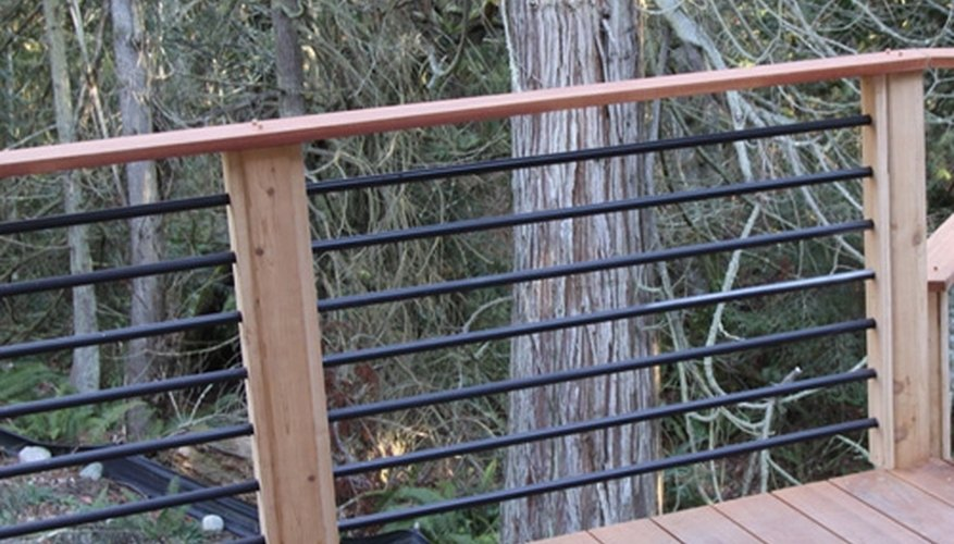Metal bars fitted into a pre-drilled wood frame