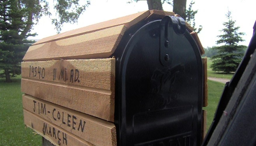 Wood covered mailbox