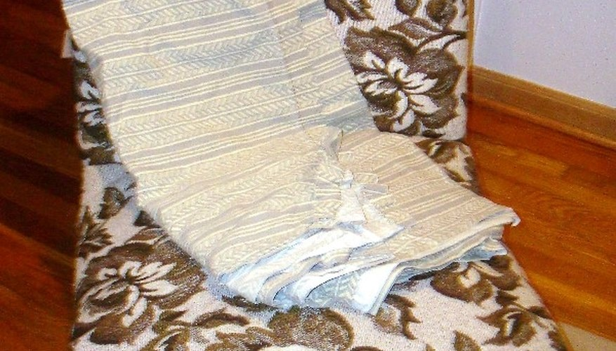 Slipcover patterns can be made with old sheets or discarded fabric.