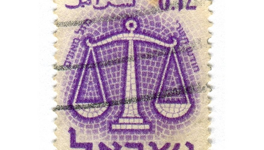 Balance scale as depicted on a postage stamp.
