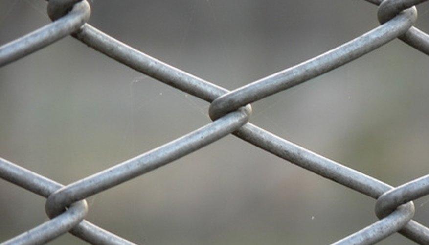 chainlink fences may sit over asphalt