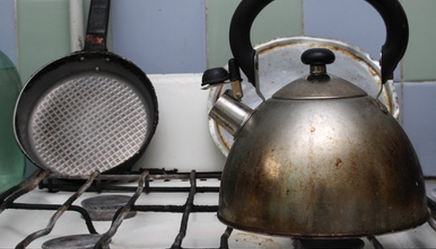 Use baking soda and vinegar to clean your stove.