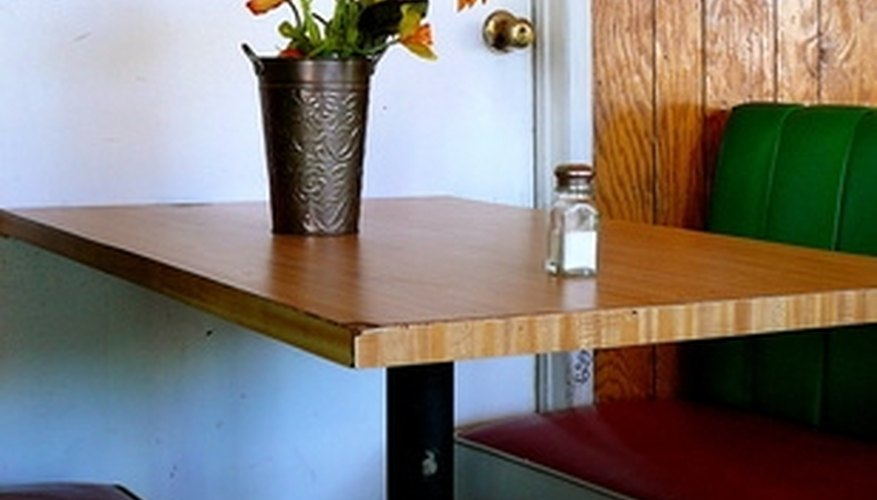 Create a booth or banquette seating arrangement for your dining room.