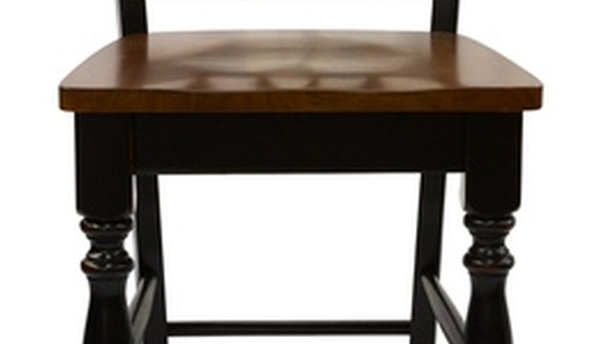 Paint your furniture to make it look antique black. How to Paint Furniture to Look Antique Black   HomeSteady