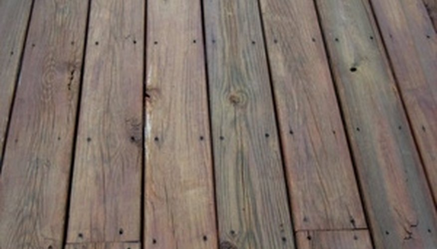 Refinish a wood deck by first removing old sealant.