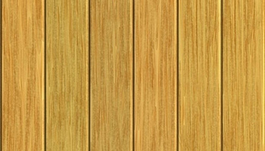 Use pressure-treated wood when building your own 8-foot wood fence.