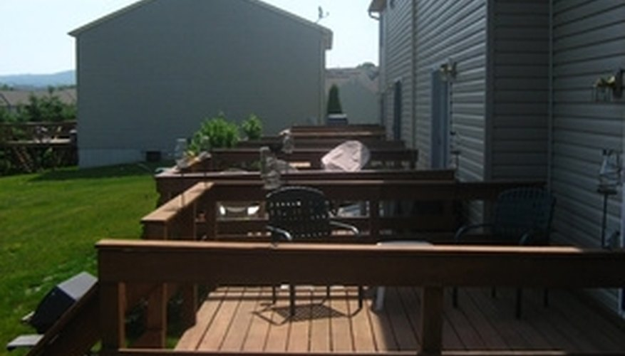 Stain an untreated wooden deck to protect it from sun and water damage.