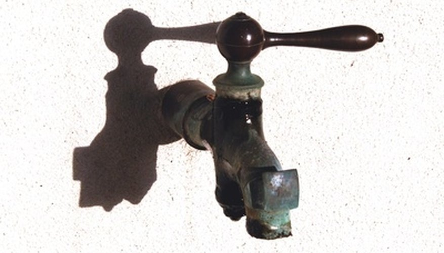 Remove faucets by heating or cutting the copper line.
