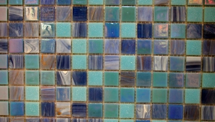 Paint over old, worn-out tiles with the correct type of paint.