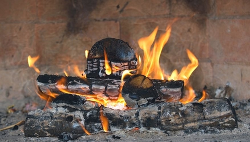 Ensure fireplace safety by removing the bark from your wood.