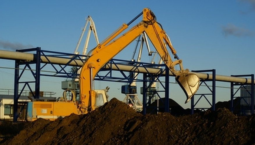 Hydraulic cylinders on this excavator provide great force to dig holes in hard ground.