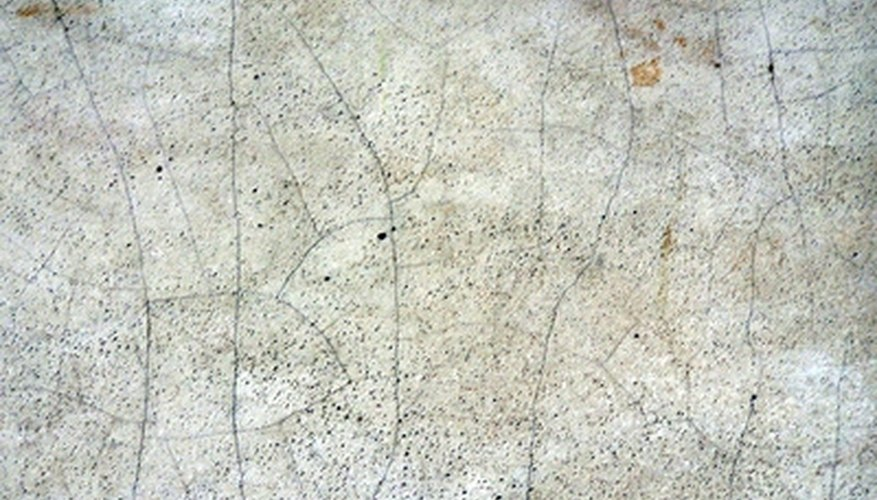 Seal basement floor cracks with concrete repair caulk.