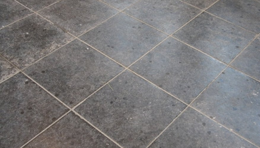 Cut laminate tile to finish your floor installation.
