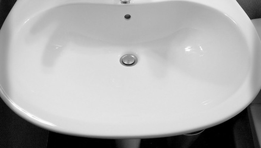Porcelain sinks can be repaired with epoxy and a porcelain-appropriate paint.