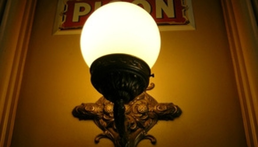 This antique wall sconce may be too high, unless the ceiling is unusually high as well.