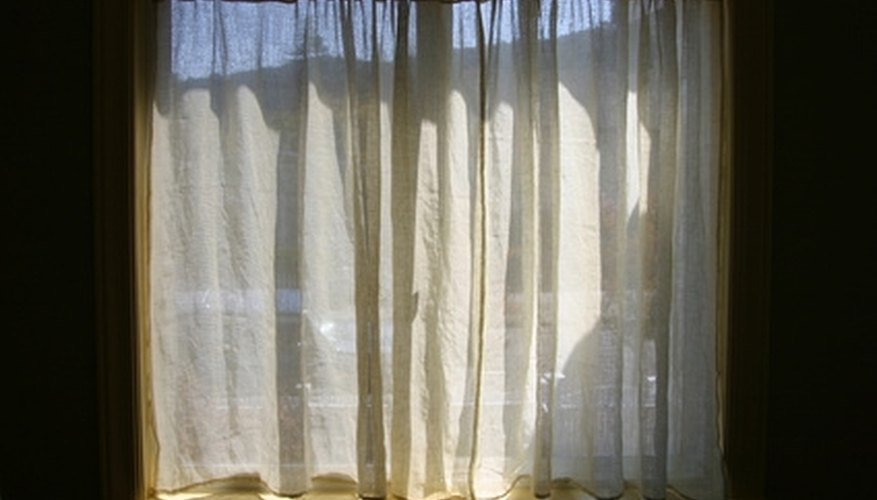 Gathered curtains can hang inside a window sill or above with a curtain pole.