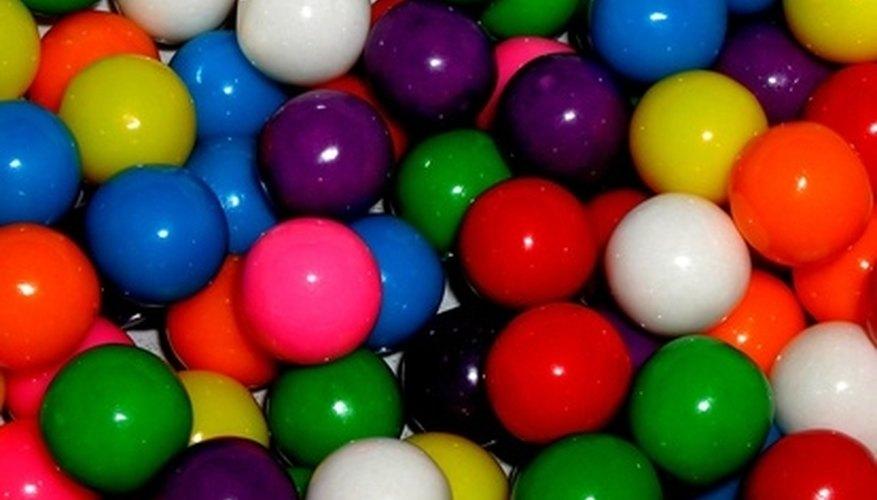 Freezing bubble gum can harden it enough to scrape off surfaces.