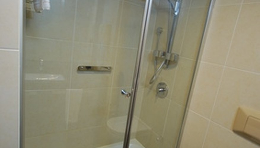 Shower doors keep the water in better than curtains.