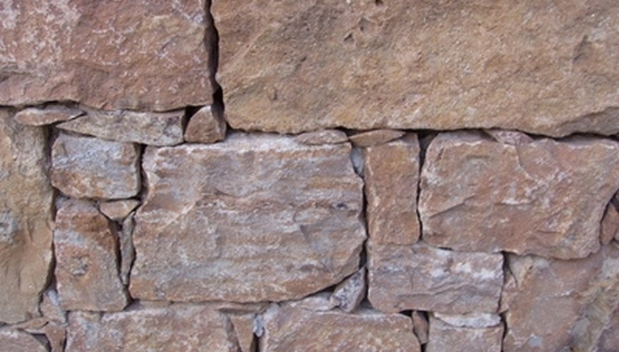 Retaining wall blocks are split to create a natural edge.
