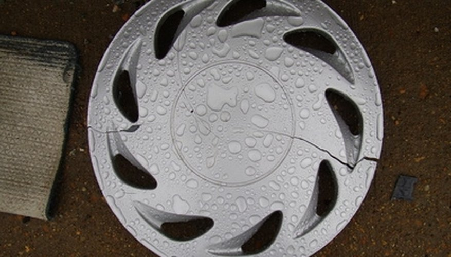 Add a clock mechanism to this hubcap for a wall decoration.