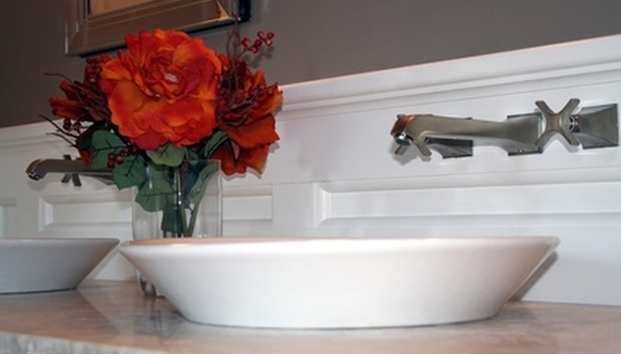 A vessel sink sits on top of the counter.