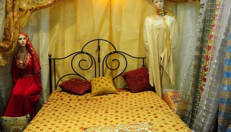 Fabrics can help frame a four poster bed.