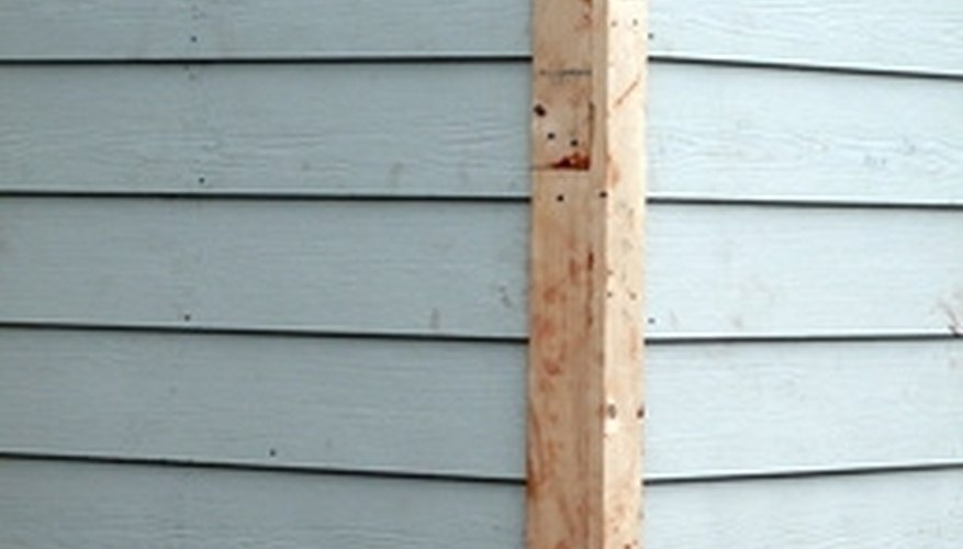 Repair wood rot in your siding by replacing the damaged areas.