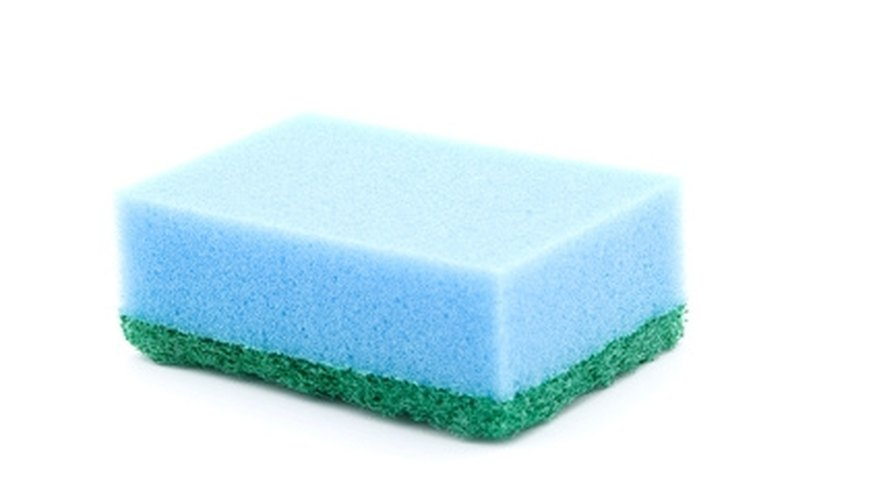 Clean stone sinks with a sponge.
