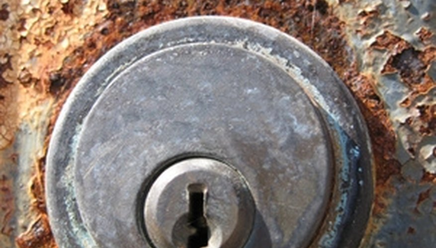 Remove your old cylinder door lock to replace it with a new one.