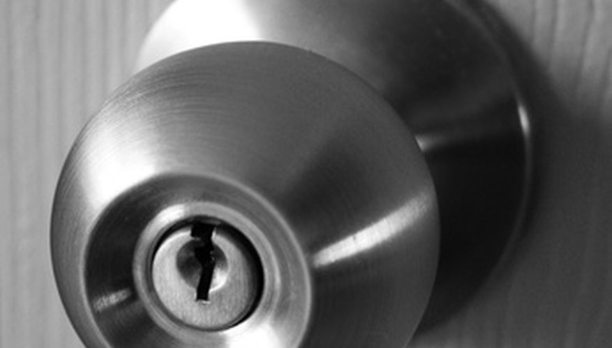 Replace door locks and knobs for security.