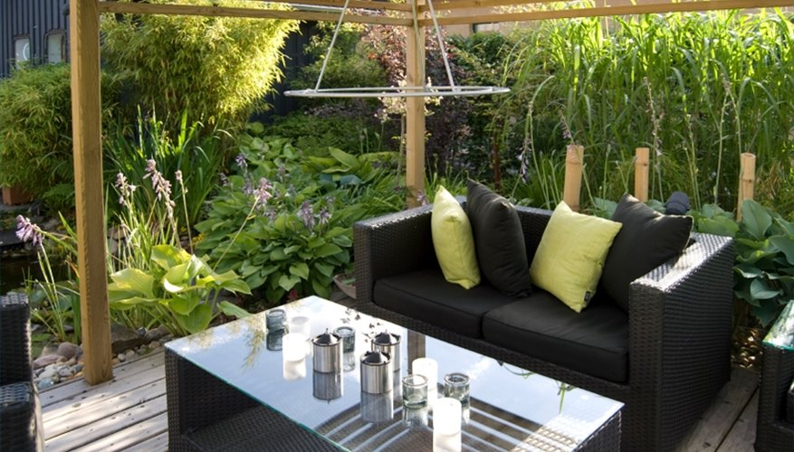 A freestanding canopy creates a shaded outdoor dining area.