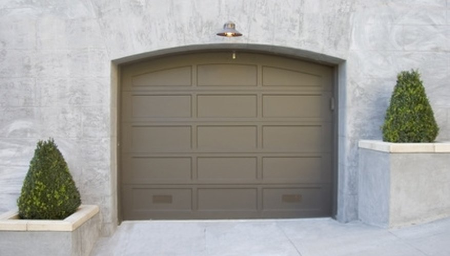 Garage door remote controls transmit a specific signal to the receiver inside that garage.