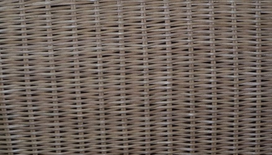 Wicker trunks consist of a rectangular wood frame covered with woven rattan.