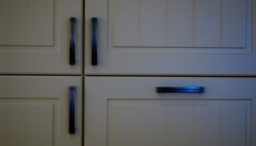 Painted cabinets can brighten  your kitchen.