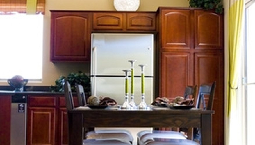 Refacing existing kitchen cabinets can save time and money.