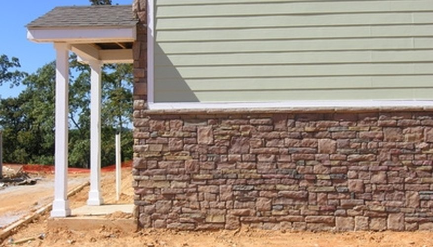 Freshen the curb appeal of an older home with an application of exterior stone.
