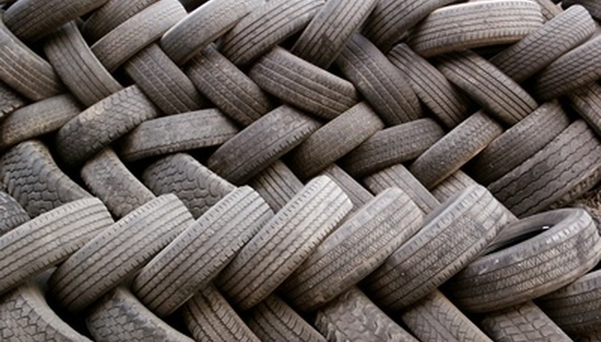 Construct a sturdy and economical retaining wall with used tires.