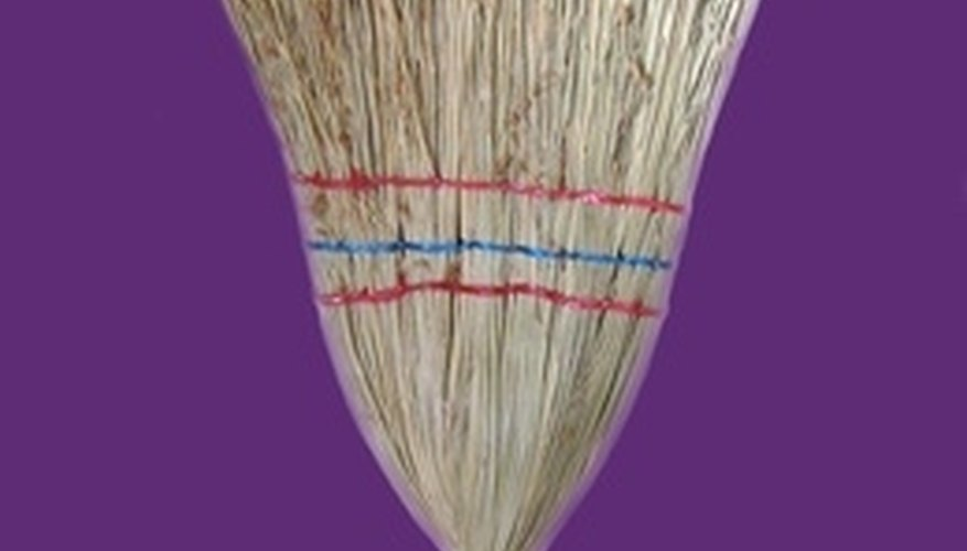 An old-fashioned broom is safer for a hardwood floor than a steam cleaner.