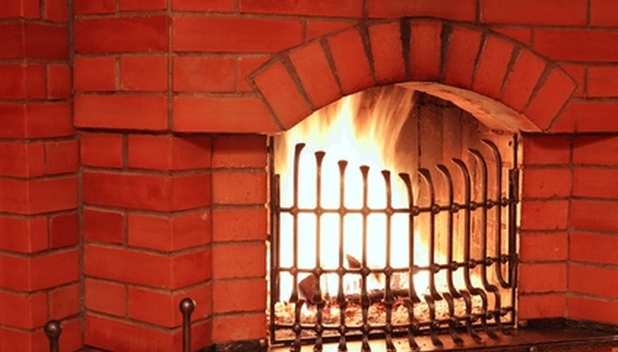 Update a red brick fireplace with your choice of materials.