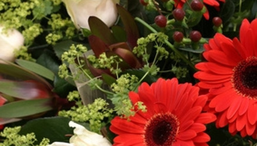 Fresh cut roses and daisies will last a long time in a bouquet when prepared correctly.