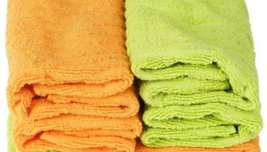 Fill a basket with vibrantly hued bath towels.