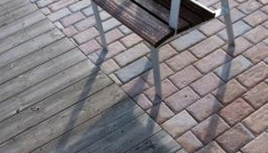 Keep algae from growing on your brick patio by opening it up to more light.
