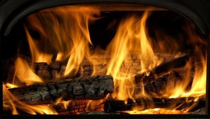 Prepare firewood for efficient burning during cold weather.