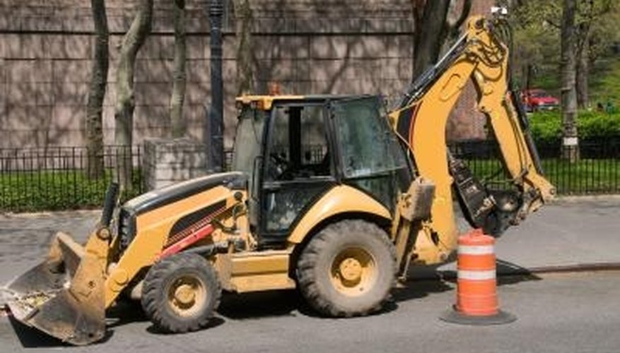 A backhoe will save you time and effort when clearing out stumps.
