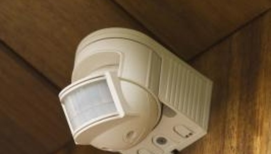 Motion sensors detect movement which triggers the alarm or lights.