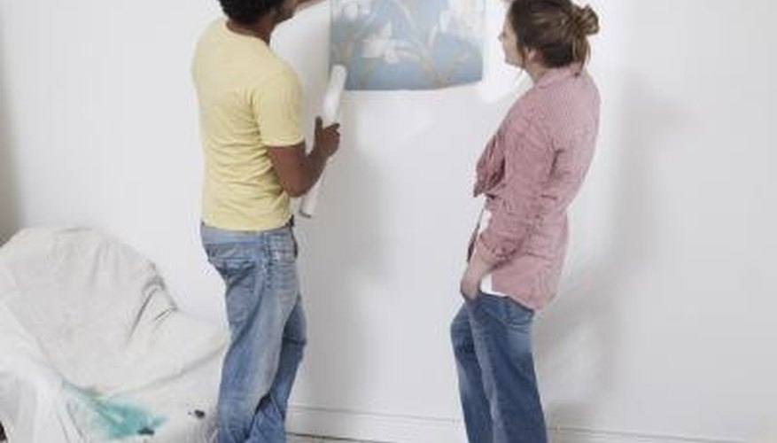 Smoothing down peeling wallpaper can help your walls look new again.